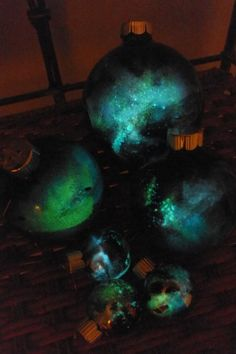 Glow-in-the-dark glass ornaments available from Etsy. These would be great on a porch or in a child's room.