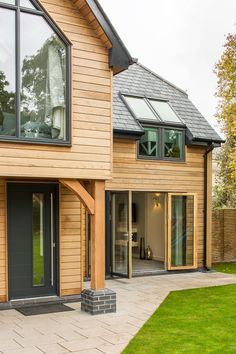 Modern Front Exterior of new house. Timber frame house with timber cladding and grey windows. Home building ideas Cost of building a house. By Potton, Self-Build Specialists Wood Cladding Exterior, Larch Cladding, House Cladding, Residential Log Cabins, Residential Architecture, Pavilion Architecture, Sustainable Architecture, Self Build Houses, Timber Frame Homes