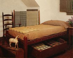 Old Prim Rope Bed with Trundle...homespun bedding & early toy horse.