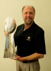 New Orleans Saints Chiropractor Dr. Rob Lizana, adjusting their Lombardi Trophy.