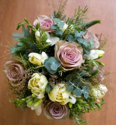 vanillarose.co.uk Hand tied bridal bouquet with amnesia roses, tulips and freesias mixed with eucalyptus and herbs.