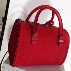 Victoria Beckham's new textured holdall bag - New York Fashion Week Autumn/Winter 2014 - handbag.com Love this Business // http://www.boojibag.com