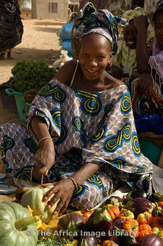 Photos and pictures of: Woman selling fresh produce in the market, Podor, Senegal - The Africa Image Library African Life, African Culture, African Women, We Are The World, People Of The World, Out Of Africa, West Africa, African Beauty, African Fashion