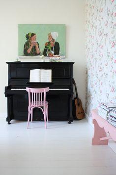 Pretty wallpaper,pink chair,piano!
