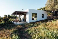 A total transformation from an old abandoned warehouse to a dreamy loft on the island of Ibiza. On a remote mountain field in the rugged north of Ibiza lies Casa Loft, Loft House, Abandoned Warehouse, New York Loft, Style Rustique, Open Space Living, Built In Bench, Spanish House, Building Structure