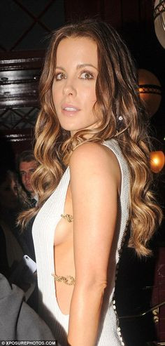 Racy:The British beauty wowed in her draped gown which highlighted her svelte figure as well as an ample amount of sideboob