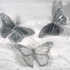 Glittered feather butterflies - adorn wedding bouquets, centerpieces, pew decorations or place settings.