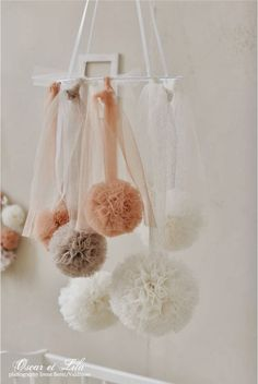 This might be a way that we could make it work hanging from one of the lights above the tables...Chandelier of sorts from tulle Pom poms