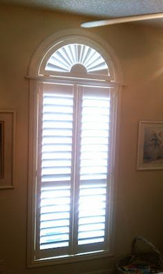 Plantation Shutter with a fan top. A perfect solution for a window with an arch or any specialty shape. This shutter was installed in Victoria TX by Casey Housworth of Budget Blinds of VIctoria TX.