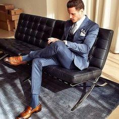 Blue grey suit, brown shoes.