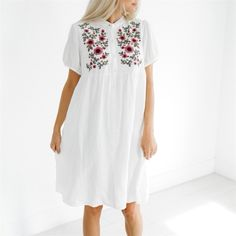 These embroidered dresses are perfection! We love the easy breezy white! The flowing loose fit! The function buttons! Nursing friendly friends! Hits just above the knee and has pockets!