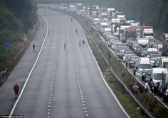 Staying entertained: Motorists played rugby (left) on the M5 in Somerset today…
