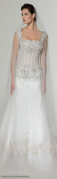 While I would prefer one style or the other (not a change in the middle of the dress) this is a beautiful gown!