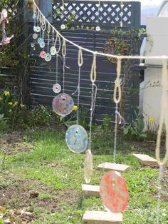 bobbin lace in resin discs hanging in the sun to dry