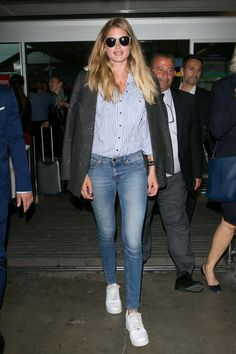 Jeans and a button-down blouse make the perfect plane-to-meeting outfit.