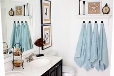 hanging towels with decorative shelf on top