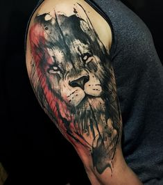 Perfect black and red tattoo art of Wild Lion head motive done by artist Marcella Alves from Sao Paulo, Brazil