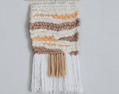 This beautiful weaving is made up of a mix of wool yarn and fibers and merino wool. This piece measures about 10 inches across and 23 inches long while the dowel is 12 inches.  These tapestries make the perfect statement piece in your home whether you use it for a gallery wall, nursery, home office, or just a stand alone piece. You cant go wrong with such beautiful colors and something that is HANDMADE!  This piece is can work for a more masculine feel or as a dark accent piece. I chose to…