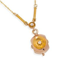 The design of this Edwardian era pendant is well ahead of its time. More akin to the configuration of a modernist item of jewelry, the overall shape is that of a geometric orb with concave indentations. The exterior of the hollow pendant is 18k rose gold with the interiors of the scoops of matte 18k yellow gold and each set with a tiny old mine cut diamond.   The indentations contrast wonderfully with the highly polished gold on the outside surface. A small rose gold knob-like orb accents…