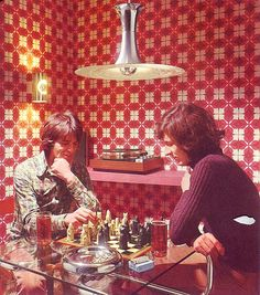 Must be difficult to concentrate on a game of chess with that wallpaper! So retro
