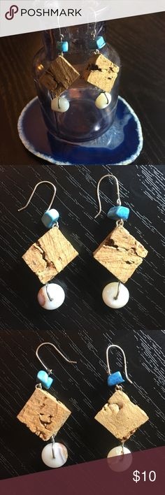 Genuine opal, turquoise, and cork earrings Genuine opal, turquoise, and cork earrings Genuine white opal gemstone circles, genuine turquoise chunks (/dyed howlite), and genuine cork diamond-shaped squares dangle from hypoallergenic silver-tone hooks. Note that while white opal sparkles beautifully, you won't see the rainbow of colors seen in other types of opal. Condition: NWOT, never worn, handmade by me! ⚠️ NOT Anthropologie, listed here because it fits the aesthetic  💰Bundle 3+ to save…