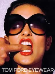 Tom Ford eyewear.. why is his middle finger in her mouth?