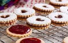 Crumbly, nutty linzer cookies, dusted with confectioners' sugar and sandwiched with tart raspberry jam. Linzer Tart, Linzer Cookies, German Cookies, Confectioners Sugar, Christmas Treats, Mini Cupcakes, Biscuits, Cookie Recipes, Raspberry