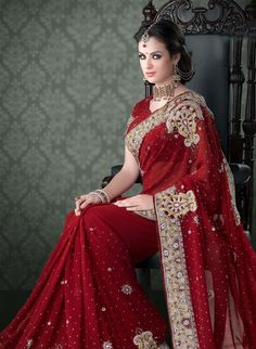 Gorgeous red sari---see more on http://www.weddingsonline.in/blog/how-to-choose-a-wedding-saree-part-1/