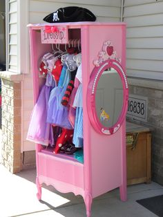 Cabinet for little girls dress up clothes made from an old dresser!