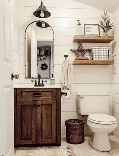 These rustic bathroom ideas will allow you to make a big impact with just a few elements. Check it now if you are a fan of rustic bathroom design! diy bathroom ideas Five Rustic Bathroom Ideas To Try At Home Downstairs Bathroom, Bathroom Wall Decor, Bathroom Interior, Farm House Bathroom, Modern Bathroom, Bathroom Lighting, Shower Bathroom, Small Cabin Bathroom, Bathroom Mirrors