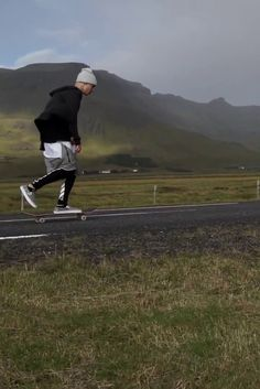 Justin Bieber wearing Hopps Big Logo Skateboard Deck, Yea. Nice Folded Beanie, Off-White c/o Virgil Abloh Stripe Print Track Pants, Fear of God Dropcrotch Drawstring Shorts, Vans Moon Slip-On