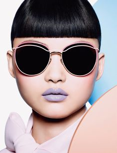 Wearing Dior sunglasses, He Cong models a purple matte lip color