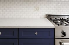 Navy blue is a classic color that is both timeless and sophisticated. A relative of black, navy adds just a hint of mystery and intrigue that isn't found in its much-darker cousin. Learn all the perks of navy cabinets in our latest blog!  #navybluekitchencabinets #navycabinets #navybluebathroom #navybluekitchen #navykitchenisland #navykitchendecor #navybathroomideas #navybathroomvanity Kitchen Tiles Design, Subway Tile Kitchen, Kitchen Backsplash, Kitchen Cabinets, Subway Backsplash, Backsplash Ideas, Subway Tiles, Tile Ideas, Kitchen Designs
