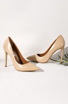 Making a sophisticated statement with these patent pointy toe pumps.