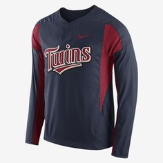 REPRESENT YOUR TEAM The Nike (MLB Twins) Men's Training Windshirt is made with fabric that resists the elements for superb comfort in changing conditions. Dynamic colors and team print in front pay tribute to your favorite club. Benefits Fabric is resistant to wind and water for comfort Insets at sides and under arms deliver natural range of motion Stretch cuffs and hem provide a secure fit Product Details Concealed front zip pockets Snap closure at the neck Fabric: 100% polyester Machine…