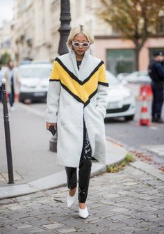 Vanessa Hong wearing a coat seen outside Sacai during Paris Fashion Week Spring/Summer 2018 on October 2 2017 in Paris France