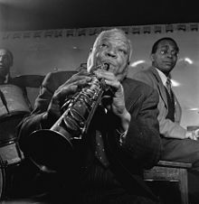 Sidney Bechet (May 14, 1897 – May 14, 1959) was an American jazz saxophonist, clarinetist, and composer.    He was one of the first important soloists in jazz (beating cornetist and trumpeter Louis Armstrong to the recording studio by several months[1] and later playing duets with Armstrong), and was perhaps the first notable jazz saxophonist. Forceful delivery, well-constructed improvisations, and a distinctive, wide vibrato characterized Bechet's playing.