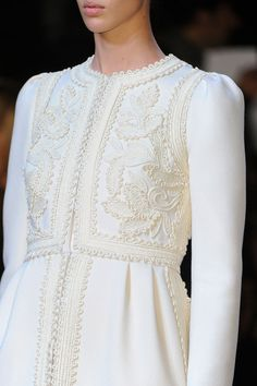 Valentino Fall '12 ...It reminds me of something medieval or renaissance or something. I can't decide whether or not I like it, but I think I might love it. Lol. :)