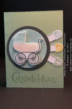 Something for Baby stamp set cut out with the matching Baby's First. The sentiment is from the Sassy Salutations. I love the baby buggy and the diaper pins bring back lots of memories. This set is filled with cute baby items and all of them have a matching die cutter! www.robynsroost.stampinup.net