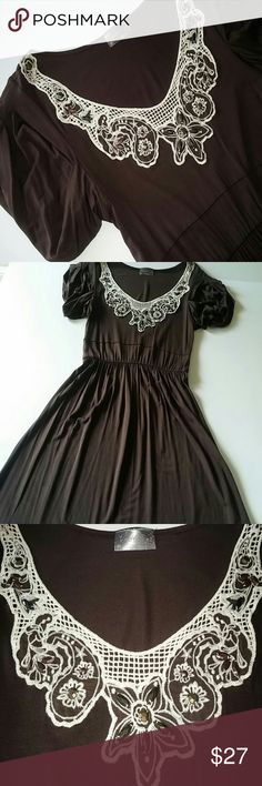 """Boho Lace Beaded V Neck Mini Dress or Tunic Top Boutique brand - Ventti Mini Dress or Tunic Top. Tagged Size Large but measures more like Medium / 8 10. Color: Brown and Cream. Pull-On Styling. V Neck edged in Lace and Beaded Detailing. Short Sleeves. Elastic Waist. Rayon/Spandex Blend. Hand Wash. Pre-owned with No Signs of Use or Wear.  Measurements: 36""""-40"""" Underarm to Underarm - doubled (flat to stretched) 24""""-30"""" at Elastic Waist - doubled (flat to stretched) 44"""" Hips - doubled 38"""" Total…"""
