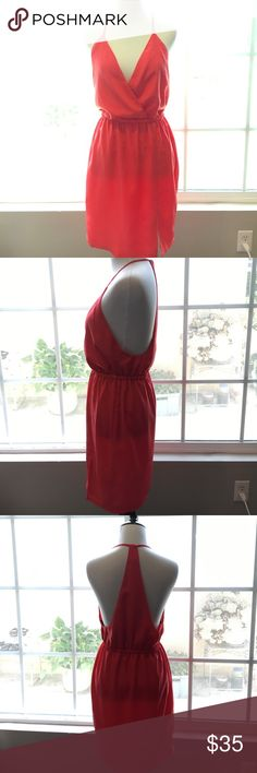 NBD coral dress with surplice top Adorable coral NBD (lovers + friends sister line) dress with surplice top, racerback, and small slit in front. Can be dressed up for date night or a wedding or dressed down with a denim jacket and sandals. A great summer addition to your wardrobe! Lovers + Friends Dresses Mini