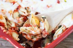 Spinach Baked Shells...this is just like one of our favorite stuffed shells recipes only this way you save some time by using mini shells and just throwing it all together!