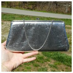 Check out this item in my Etsy shop https://www.etsy.com/listing/275053294/vintage-metallic-silver-purse-vinyl-or