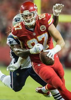 Kansas City Chiefs tight end Travis Kelce (87) caught a first down pass in the first quarter, tackled by New England Patriots outside linebacker Dont'a Hightower (54) at Arrowhead Stadium in Kansas City, Mo. on Monday night, September 29, 2014.