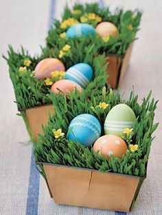 Nestle dyed eggs into baskets filled with wheat grass and sprigs of phlox and line them up along the center of your table.