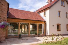 Beautifully crafted oak framed garden room with curved braces.