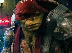 "Raphael looks at Casey Jones after Casey Jones says, ""Who are you calling chicken, turtle?"""