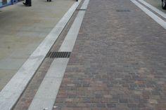 Widemarsh Street Sidewalk   Porphyry Setts   Silver Grey Granite Paving & Kerb