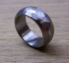 This gorgeous distressed ring is simple but stunning. Weve taken one of our titanium rings and given it a softly rounded profile and a beautiful, hand