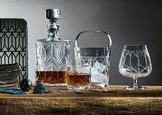 This crystal Whisky Tumbler from Vista Alegre brings Hollywood glamour into the modern day with a barware geometric Art Deco pattern on sleek silhouettes. Whisky Tumbler, Bar Cart Styling, Whiskey Decanter, Candle Diffuser, Crystal Decanter, Old Fashioned Glass, Highball Glass, Interior Design Magazine, Bars For Home